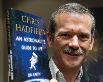 "EDS NOTE: A FILE PHOTO Canadian astronaut Chris Hadfield holds a copy of his book ""An Astronaut's Guide to Life on Earth"" in Montreal on November 27, 2013. THE CANADIAN PRESS/Ryan Remiorz"